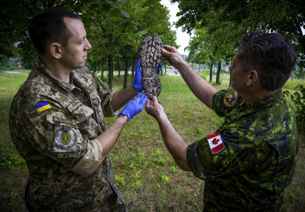 The sun never sets on Canadian Military Police - Blue Line
